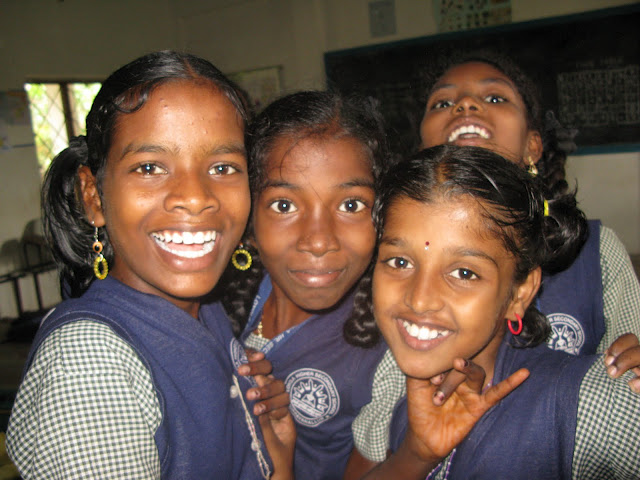 Seventh-grade students tat the Loyola Higher Secondary School in Kuppayanallur, Tamil Nadu, India.